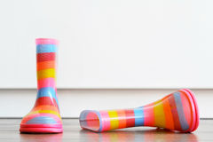 Pair of colorful boots on the floor Royalty Free Stock Images