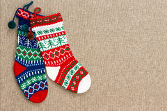 Pair of colorful patterned Christmas stockings Royalty Free Stock Photo