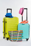 Pair of colorful wheeled suitcases. Man and woman summer accessories Royalty Free Stock Image