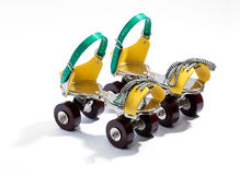 Pair of colorful yellow and blue roller skates Stock Image