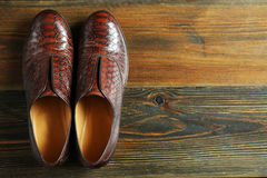 A pair of comfortable shoes on a wooden surface Stock Photo