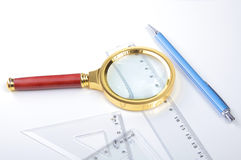 Pair of compasses drawing circle on a paper Stock Image