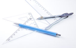 Pair of compasses drawing circle on a paper Stock Photos