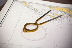 Pair of compasses for navigation on a sea map Royalty Free Stock Image