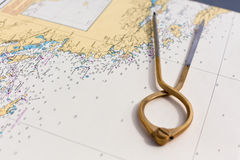 Pair of compasses for navigation on a sea map Stock Image