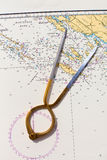 Pair of compasses for navigation on a sea map Royalty Free Stock Photo