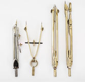 Pair of Compasses and Other Drawing Instruments Royalty Free Stock Photos