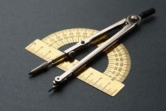 Pair of compasses and protractor Royalty Free Stock Photos