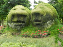 A pair of concrete heads with living features Stock Photography