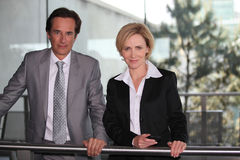 Pair of confident executives. Stood together outdoors royalty free stock photography