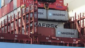 Pair of containers loaded in a big containership of Maersk Lines. Containers special crane downloading a containership of Maersk Lines in Algeciras harbour in stock video footage
