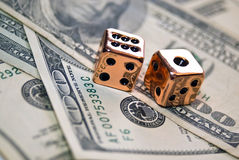 Pair of Copper Dice On Money. Your own personal copper dice, (a metaphor for business, success,wealth, etc.) sitting on money to add a different twist to the royalty free stock photos