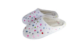 Pair of cosy slippers. Pair of cosy old white slippers with colorful spots Royalty Free Stock Images