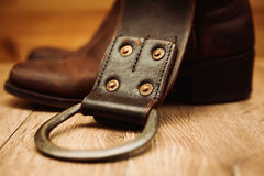Pair of cowboy boots and belt. Pair of cowboy boots and leather belt Stock Images