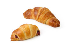 Pair croissants with strawberry filling Royalty Free Stock Photo