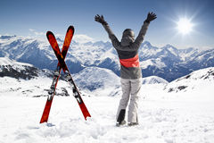 Pair of cross skis with woman skier, hands up Royalty Free Stock Photos