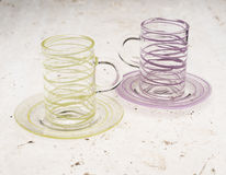 Pair of Crystal Cups with Matching Saucers on Stone Surface Royalty Free Stock Photography
