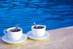 A pair of cups on the poolside Stock Photos