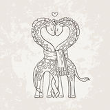 A pair of cute giraffes in love with a common scarf. Neck curved in the shape of heart. Royalty Free Stock Images