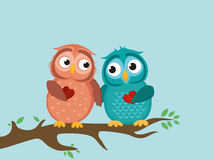 A pair of cute owlet sittinA pair of cute owlet sitting on branch Royalty Free Stock Image