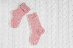 A pair of cute small different colored cashmere knitted newborn royalty free stock photography