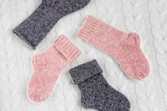 A pair of cute small different colored cashmere knitted newborn royalty free stock photo