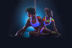 Pair of cute young dancers posing with neon makeup Royalty Free Stock Image