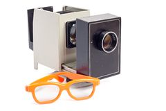 Pair of 3-d cinema glasses and projector isolated on white background Stock Image