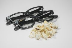 Pair of 3D Glasses and Salty Popcorn Royalty Free Stock Images