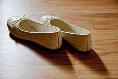 Pair of dance shoes. Pair of  dance shoes on a wooden dance floor Royalty Free Stock Photo