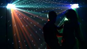 Pair dancers dancing in spotlight at the club stock footage