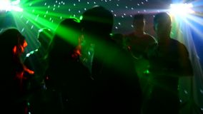 Pair dancers dancing spotlight at club, silhouette stock footage