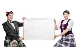 Pair of dancers of Scottish dance with empty banner Stock Image