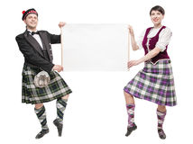 Pair of dancers of Scottish dance with empty banner Royalty Free Stock Photography