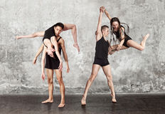Pair of dancing contemporary dance. In black body Stock Image