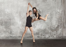 Pair of dancing contemporary dance. In black body Royalty Free Stock Images