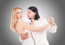 Pair dancing dances against the gradient Stock Photography