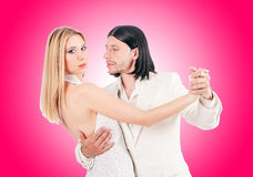 Pair dancing dances against the gradient Royalty Free Stock Photography