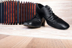 Pair of dancing schoes and bandoneon Stock Photography