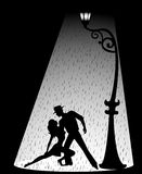 Pair dancing a tango. Silhouette of a loving couple dancing a tango Stock Photo