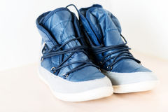 Pair of dark blue female boots with shoe string horizontal Stock Images