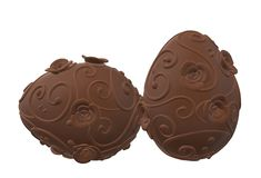 A pair of dark brown flowery patterned easter egg chocolate candy. A computer generated illustration image of a pair of dark brown flowery patterned easter egg stock illustration