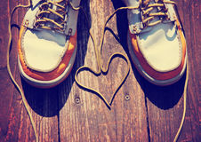 A pair of deck shoes on a nice wooden porch with the laces Stock Images