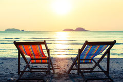 Pair of deckchairs on a Sunny beach. Relax. Stock Photo