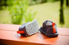 Pair of denim baby shoes for the toddlers feet. Stock Photo