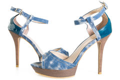 Pair of denim stiletto shoes on white Royalty Free Stock Images