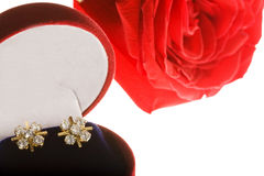 Pair of Diamond Earrings and a Red Rose. Photo of a Pair of Diamond Earrings and a Red Rose stock photos