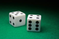 Pair of Dice over green. A close up shot of a pair of dice Stock Images