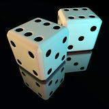 Pair of dice on a reflective surface. Double six Stock Photo
