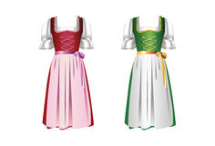 A pair of dirndl dresses. A pair of traditional Austrian dirndls with color variations stock illustration